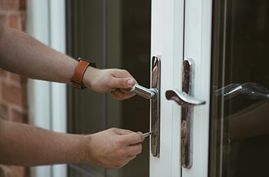 Person unlocking door